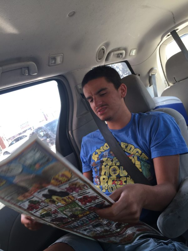 Kyle Reading the Sprouts Ad.